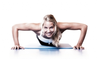 Nice young woman doing push-ups in fitness club. [url=http://www.istockphoto.com/file_search.php?action=file&lightboxID=1265817][img]http://santoriniphoto.com/Template-Sport.jpg[/img][/url]
